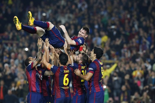 Barcelona's Messi celebrates his goal with teammates during their Spanish first division soccer match against Sevilla at Nou Camp stadium in Barcelona